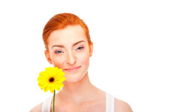 Woman with yellow flower near her face Stock Photos