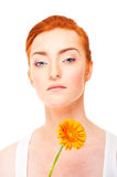 Woman with yellow flower near her face Stock Photo