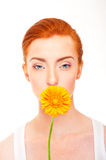 Woman with yellow flower near her face on white background Royalty Free Stock Images