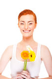 Woman with yellow flower near her face on white background Stock Images