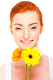 Woman with yellow flower near her face on white background Stock Photos