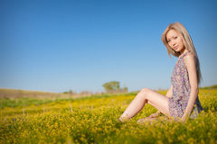 woman with yellow flower portrait Stock Photos