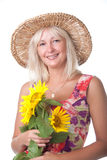 A woman with yellow flowers. A woman with yellow flowers in the hat Stock Photos