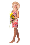 A woman with yellow flowers. A woman with yellow flowers in the hat Stock Photography