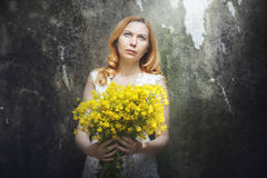 Woman with yellow flowers Royalty Free Stock Photos