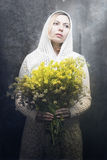 Woman with yellow flowers Stock Photo