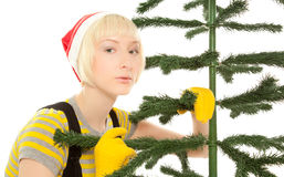 Woman in yellow gloves with fir Royalty Free Stock Images