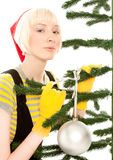 Woman in yellow gloves with fir Royalty Free Stock Image