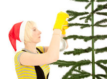 Woman in yellow gloves with fir Stock Images
