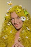 Woman with yellow hair, flowers, and bees in them Stock Image