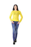 Woman in yellow with hands on waist Royalty Free Stock Photography