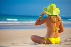 Woman in yellow hat Royalty Free Stock Image