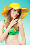 Woman in yellow hat and bikini portrait Royalty Free Stock Photos