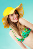 Woman in yellow hat and bikini portrait Royalty Free Stock Photography