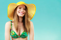 Woman in yellow hat and bikini portrait Royalty Free Stock Photo
