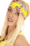 Woman yellow headband close side smile Stock Image