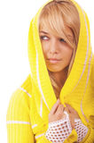 Woman in yellow hood Stock Images