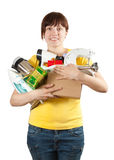 Woman in yellow with household appliances Royalty Free Stock Images