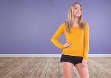 Woman in yellow jumper posing in purple room stock photo