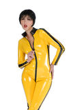 Woman in yellow latex Stock Photography