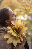 Woman and yellow leaves. Girl and yellow leaves at autumn Royalty Free Stock Photo