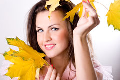 Woman with yellow leaves Royalty Free Stock Image