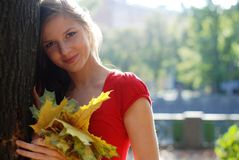 Woman with yellow  leaves Stock Photography