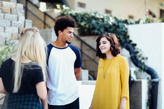 Woman in Yellow Long Sleeved Dress Standing Beside Man in White Blue Crew Neck T Shirt Royalty Free Stock Image