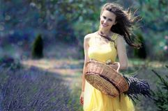 Woman in Yellow Maxi Dress Holding Brown Woven Picnic Basket Walking During Daytime Stock Photo