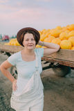 Woman with yellow melons Royalty Free Stock Photo