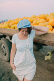 Woman with yellow melons Royalty Free Stock Image