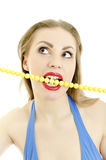 Woman with yellow necklace in her mouth. Stock Photography