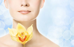 Woman with yellow orchid Stock Images