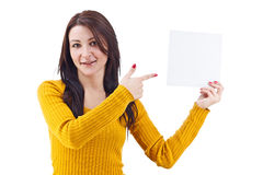 Woman in yellow pointing a blank page Royalty Free Stock Photography