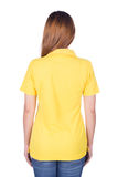 Woman in yellow polo shirt isolated on white background back si Stock Photography