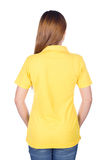 Woman in yellow polo shirt isolated on white background back si Royalty Free Stock Image