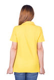Woman in yellow polo shirt isolated on white background back si Royalty Free Stock Photography