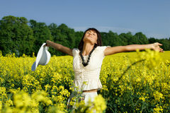 Woman in the yellow field. Young woman in the yellow field royalty free stock image