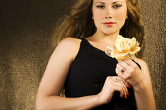 Woman with yellow rose Royalty Free Stock Photography