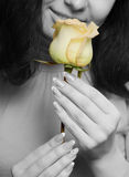The woman with a yellow  rose closeup Stock Images