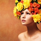 Woman with Yellow Roses. Model Girl with Flowers Hair Royalty Free Stock Photo