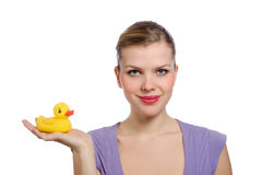 Woman with a yellow rubber duck on her hand Stock Photos