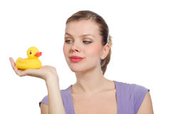 Woman with a yellow rubber duck on her hand Stock Image