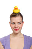 Woman with a yellow rubber duck on her head Stock Image