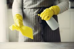 Woman in yellow rubber protective gloves wiping dust and dirty. Cleaning concept, banner, copy space.  Royalty Free Stock Photos