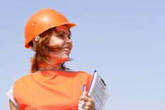 Woman with yellow safety helme Royalty Free Stock Photos
