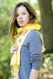Woman in yellow scarf stock images