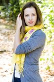Woman in yellow scarf stock image