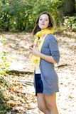 Woman in yellow scarf in autumn colors Stock Images