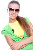 Woman in a yellow shirt and green jacket Royalty Free Stock Photos